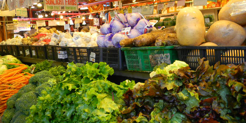 Grocery shelves stocked with healthy vegetables